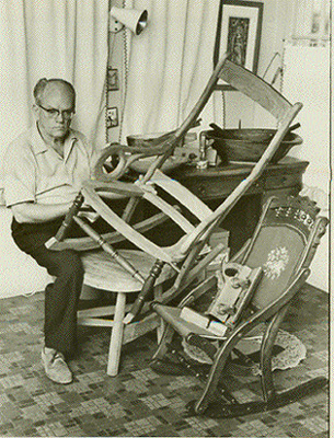Harry Lester Taylor working on furniture